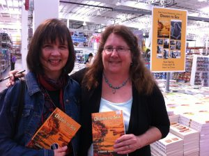 Paula and Yvonne at a Drawn to Sea book signing. Photo by Theda Phoenix.
